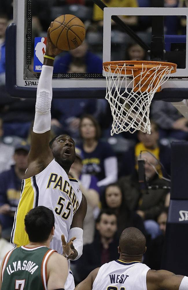Indiana Pacers' Roy Hibbert (55) dunks during the first half of an NBA basketball game against the Milwaukee Bucks, Thursday, Feb. 27, 2014, in Indianapolis