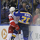 Detroit Red Wings' Drew Miller, left, collides with St. Louis Blues' Ryan Reaves (75) along the boards in the first period of an NHL hockey game, Thursday, Jan. 15, 2015, in St. Louis The Associated Press