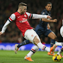 Arsenal's Jack Wilshere takes a shot at goal during their English Premier League soccer match between Arsenal and Manchester United at the Emirates stadium in London, Wednesday, Feb. 12, 2014