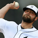 Detroit Tigers relief pitcher Joba Chamberlain warms up before the seventh inning of an exhibition baseball game against the Pittsburgh Pirates in Lakeland, Fla., Tuesday, March 4, 2014. The Pirates won 5-2 The Associated Press