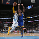 Denver Nuggets guard Randy Foye, left, drives for shot as Golden State Warriors forward Harrison Barnes covers in the fourth quarter of the Warriors' 116-112 victory in an NBA basketball game in Denver on Wednesday, April 16, 2014 The Associated Press