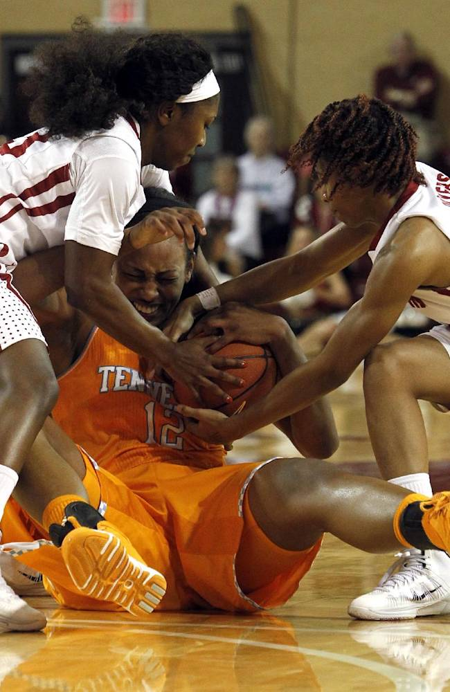 Alabama's Sharin Rivers, left, and Shafontaye Myers, right, fight over a loose ball with Tennessee's Bashaara Graves, center, during the second half of an NCAA college basketball game on Sunday, Feb. 2, 2014, in Tuscaloosa, Ala