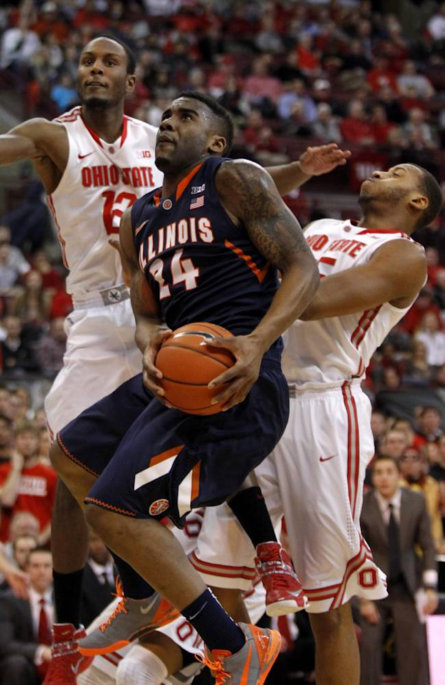 Illinois Rayvonte Rice (24) goes up for a shot between Ohio State's Sam Thompson (12) and Trey McDonald (55) during the first half of an NCAA college basketball game in Columbus, Ohio, Thursday, Jan. 23, 2014. ( AP Photo/Paul Vernon)