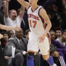 FILE - In this Feb. 10, 2012, file photo, New York Knicks' Jeremy Lin reacts after making a 3-point basket during the second half of an NBA basketball game against the Los Angeles Lakers in New York. Lin will visit the Houston Rockets on Wednesday, June 4, 2012, two people with knowledge of the plans said, and the Knicks restricted free agent is expected to get a contract offer. The Rockets waived Lin last December and he was claimed by the Knicks, turning into a breakout star when he landed the starting point guard job. Now with Goran Dragic not expected to return, Houston may want Lin back. (AP Photo/Frank Franklin II, File)