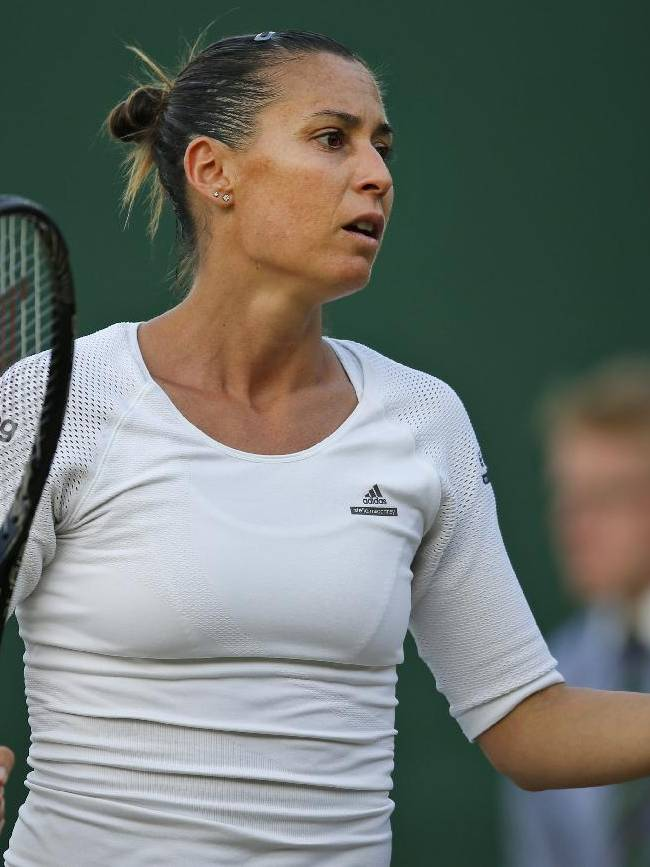 Flavia Pennetta of Italy gestures to Lauren Davis of U.S. during their women's singles match at the All England Lawn Tennis Championships in Wimbledon, London, Wednesday, June 25, 2014