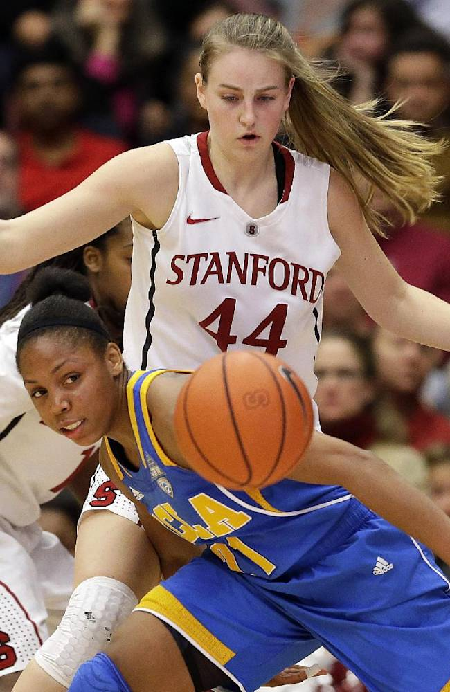 UCLA 's Nirra Fields looks to control the ball in front of Stanford 's Karlie Samuelson (44) during the first half of an NCAA college basketball game Friday, Jan. 24, 2014, in Stanford, Calif