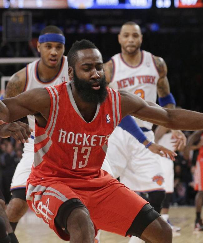 Houston Rockets' James Harden (13) works for control of the ball with New York Knicks' Iman Shumpert during the second half of an NBA basketball game Thursday, Nov. 14, 2013, in New York. The Rockets won 109-106