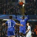Chelsea's Demba Ba, right, celebrates the opening goal with Chelsea's Oscar during the Champions League Group E soccer match between Chelsea and Steaua Bucharest at Stamford Bridge Stadium in London Wednesday, Dec. 11, 2013