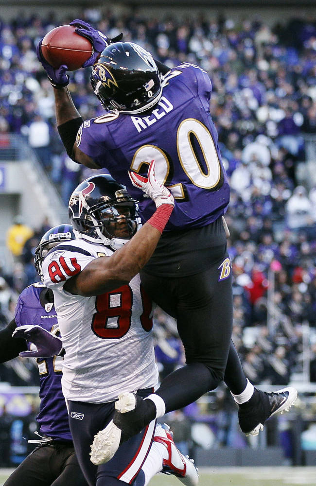 FILE - In this Jan. 15, 2012 file photo, Baltimore Ravens free safety Ed Reed intercepts a pass intended for Houston Texans wide receiver Andre Johnson during the second half of an NFL divisional playoff football game in Baltimore. The Houston Texans will meet with free agent Reed on Thursday, March 14, 2013. The team said on its Twitter site that general manager Rick Smith is flying to pick up Reed in a private jet owned by team owner Bob McNair.  (AP Photo/Patrick Semansky, File)