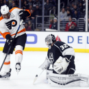 Philadelphia Flyers right wing Wayne Simmonds, left, looks for a rebound as Los Angeles Kings goalie Jonathan Quick makes a stick-save during the first period of an NHL hockey game, Saturday, Dec. 6, 2014, in Los Angeles The Associated Press