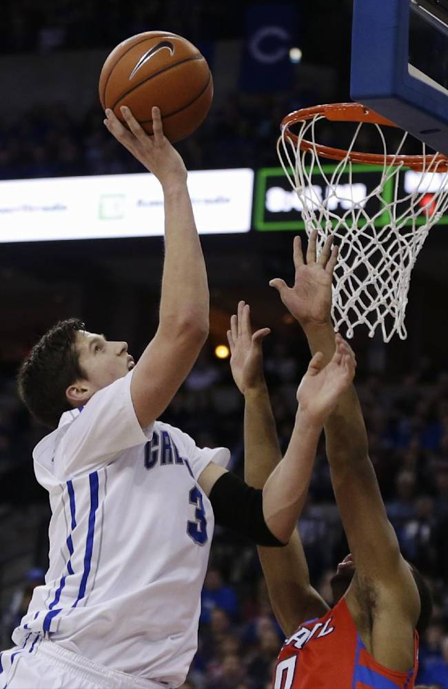 Creighton's Doug McDermott (3) shoots over DePaul's R.J. Curington (0) in the first half of an NCAA college basketball game in Omaha, Neb., Friday, Feb. 7, 2014