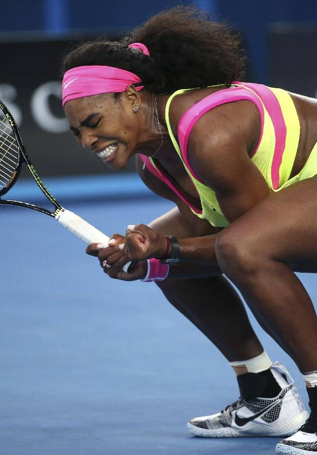 In this Tuesday, Jan. 20, 2015 photo, Serena Williams of the U.S. celebrates a point won against Alison Van Uytvanck of Belgium during their first round match at the Australian Open tennis championship in Melbourne, Australia