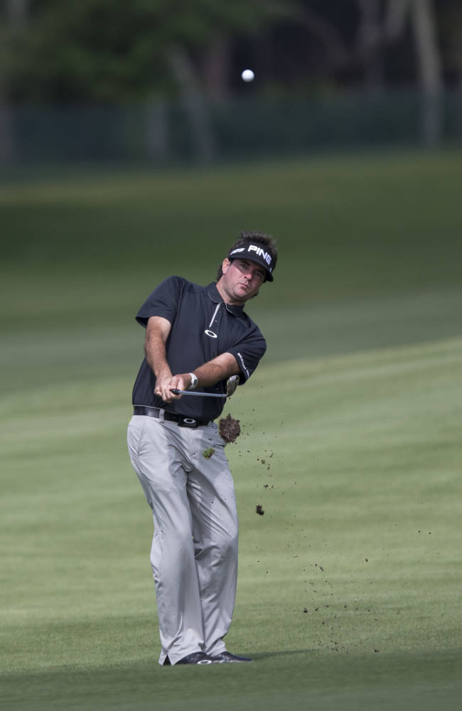 Bubba Watson chips the ball to the 5th hole during the first round of the Arnold Palmer Invitational golf tournament at Bay Hill Thursday March 20, 2014, in Orlando, Fla