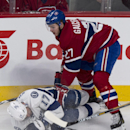 Tampa Bay Lightning's Alex Killorn is dumped by Montreal Canadiens' Alex Galchenyuk during the first period of an NHL hockey game Tuesday, Jan. 6, 2015, in Montreal The Associated Press