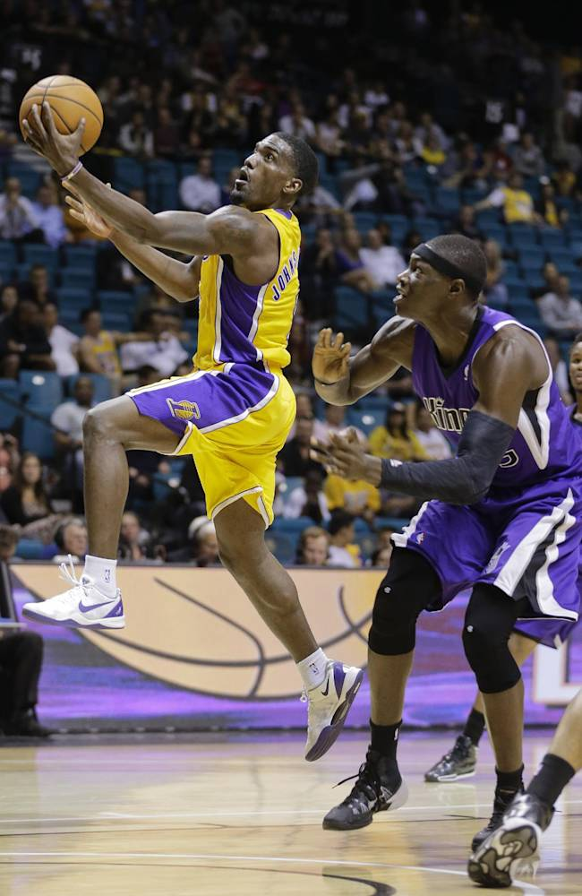 Los Angeles Lakers shooting guard Darius Johnson-Odom (6) puts up a layup against Sacramento Kings center Hamady Ndiaye (55) in the fourth quarter of a preseason NBA basketball game, Thursday, Oct. 10, 2013, in Las Vegas.  The Kings won 104-86
