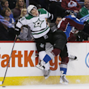 Dallas Stars defenseman David Schlemko, left, reacts as he is checked into the boards by Colorado Avalanche center Matt Duchene in the first period of an NHL hockey game Saturday, Jan. 10, 2015, in Denver The Associated Press