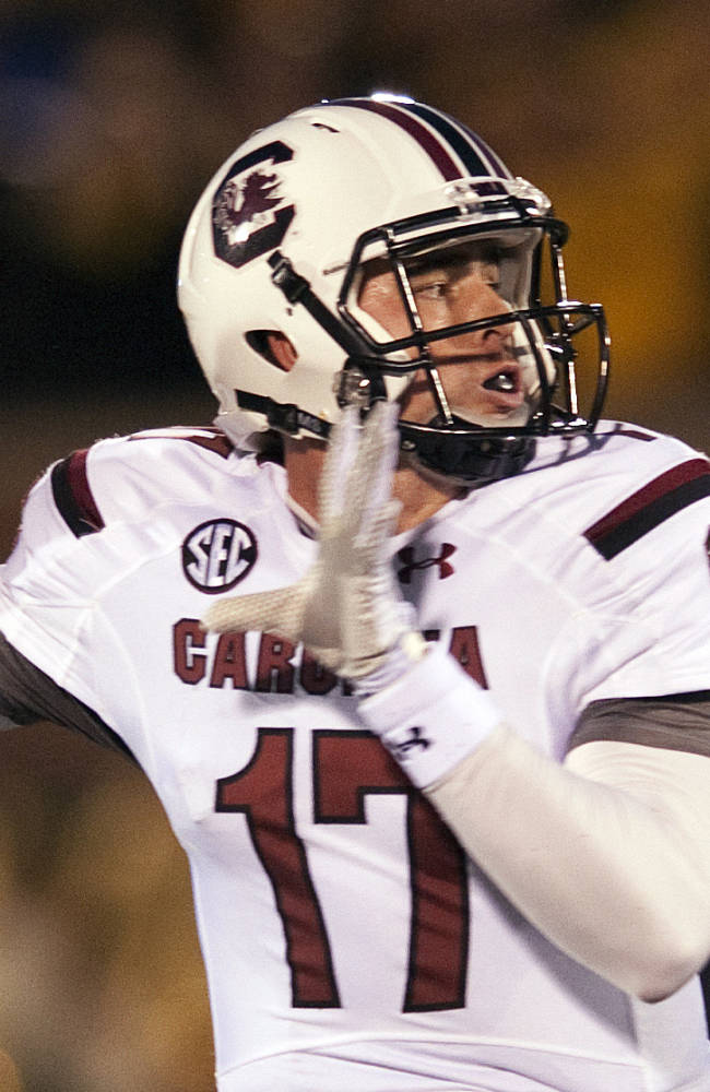 FILe - In this Oct. 26, 2013 file photo, South Carolina quarterback Dylan Thompson throws a pass during the first quarter of an NCAA college football game against Missouri, in Columbia, Mo. Thompson's made a college career out of a few big moments that South Carolina fans won't ever forget. Now, Thompson's under center from the start and he understands that what he did before won't matter much if he can't succeed as starter