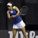 France's Caroline Garcia returns a ball to United States' Madison Keys during a Fed Cup singles world group playoff tennis match Sunday, April 20, 2014, in St. Louis. Garcia won 6-4, 6-3.(AP Photo/Jeff Roberson)