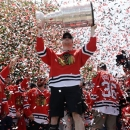 Chicago Blackhawks left wing Bryan Bickell (29) holds up the Stanley Cup Trophy during a rally in Grant Park for the NHL Stanley Cup hockey champions Friday, June 28, 2013, in Chicago. (AP Photo/Nam Y. Huh)