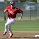 Philadelphia Phillies second baseman Chase Utley runs during a drill in a spring training baseball practice Wednesday, Feb. 19, 2014, in Clearwater, Fla The Associated Press