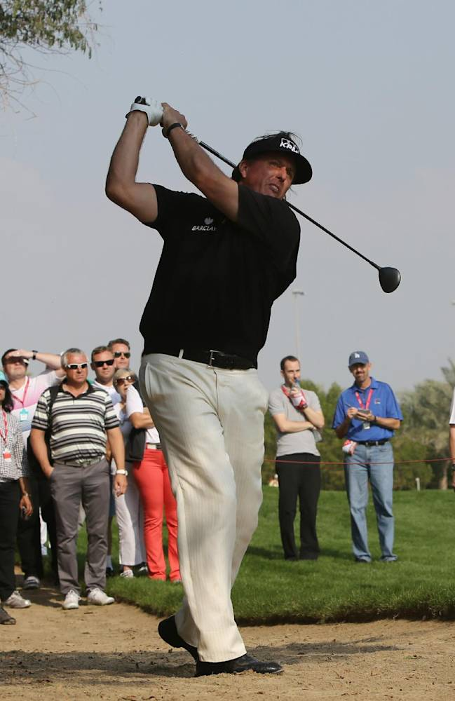 Phil Mickelson of the U.S. follows his ball on the 2nd hole during the 1st round of the Abu Dhabi HSBC Golf Championship in Abu Dhabi, United Arab Emirates, Thursday, Jan. 16, 2014