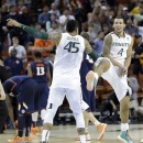 Miami's Julian Gamble (45) and Trey McKinney Jones (4) celebrate after a third-round game of the NCAA college basketball tournament against the Illinois Sunday, March 24, 2013, in Austin, Texas. Miami won 63-59. (AP Photo/Eric Gay)