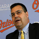 Baltimore Orioles Executive Vice-President of Baseball Operations Dan Duquette introduces Nelson Cruz to the media during a news conference at the Ed Smith Stadium complex before the team's baseball spring training workout in Sarasota, Fla., Tuesday, Feb. 25, 2014. (AP Photo/Gene J. Puskar)