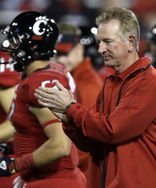 Cincinnati coach Tommy Tuberville cheers on his players at the start of an NCAA college football game against Temple, Friday, Oct. 11, 2013, in Cincinnati