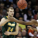In this March 22, 2014 file photo, North Dakota State's Taylor Braun (24) passes as San Diego State's Xavier Thames defends in a third-round game of the NCAA men's college basketball tournament in Spokane, Wash. Braun was named Monday, March 31, 2014, as