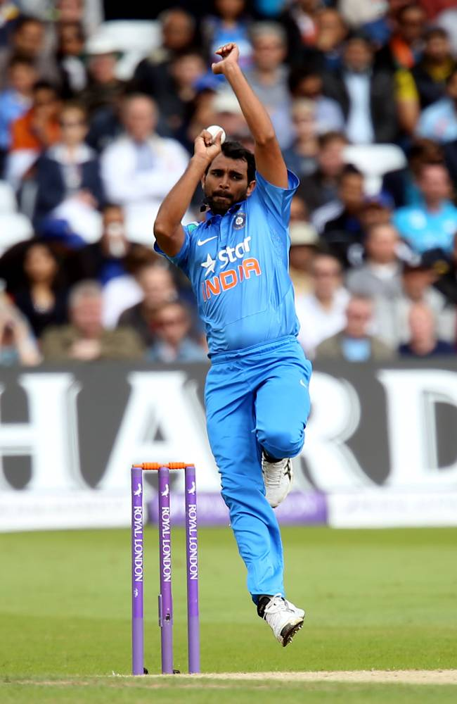 India's Mohammed Shami bowls during their One Day International cricket match against England at the Trent Bridge cricket ground in Nottingham, England, Saturday, Aug. 30, 2014