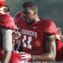 FILE - In this Aug. 5, 2014, file photo, Oklahoma's Dorial Green-Beckham takes a water break during NCAA college football practice in Norman, Okla. Green-Beckham will not be allowed to play for Oklahoma this season after the NCAA denied the school's request for a waiver that would have made the talented receiver eligible to play right now. The school announced the decision Friday night, Aug. 22, 2014. (AP Photo/Sue Ogrocki, File)