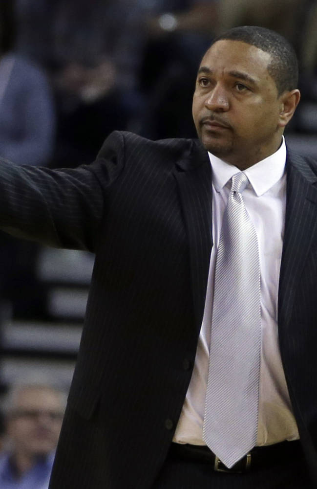 Golden State Warriors coach Mark Jackson gestures on the sideline during the first half of the Warriors' NBA basketball game against the Orlando Magic on Tuesday, March 18, 2014, in Oakland, Calif
