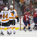 Philadelphia Flyers center Claude Giroux, left, celebrates his first-period goal against the Washington Capitals with teammates Kimmo Timonen, center, and Scott Hartnell on Sunday, March 2, 2014, in Washington. The Flyers defeated the Capitals 5-4 in over