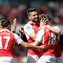 Arsenal's Olivier Giroud, center, celebrates scoring their first goal of the game with teammates during their English Premier League soccer match against Aston Villa at the Emirates Stadium, London, Sunday, May 15, 2016. (Scott Heavey/PA via AP) UN