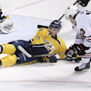 Nashville Predators defenseman Roman Josi (59), of Switzerland, blocks a shot by Chicago Blackhawks center Patrick Sharp (10) during the first period of an NHL hockey game Saturday, April 12, 2014, in Nashville, Tenn The Associated Press