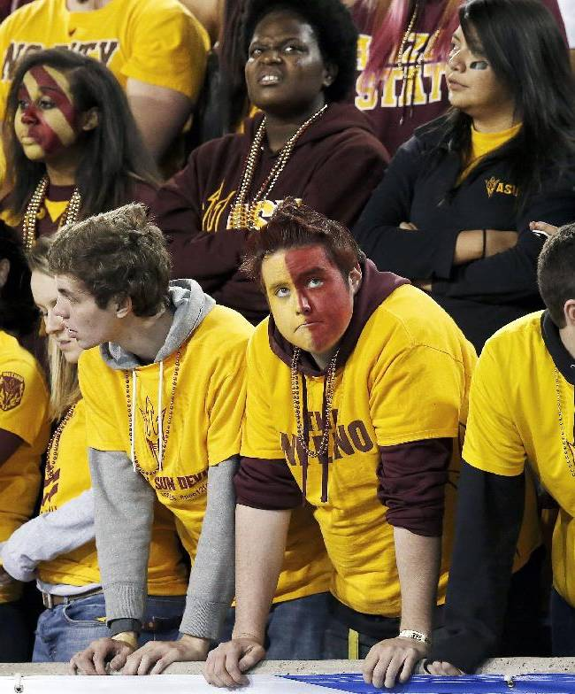 Arizona State students stand silent after a Stanford touchdown during the first half of the NCAA Pac-12 Championship football game Saturday, Dec. 7, 2013, in Tempe, Ariz. Stanford won 38-14