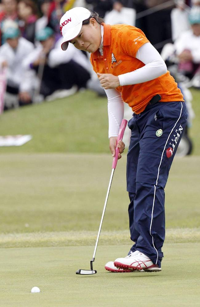 Minami Katsu celebrates while sinking a par putt on the 18th green to win the Vantelin Ladies Open golf tournament at Kumamoto Airport Country Club in Kumamoto, southwestern Japan, Sunday, April 20, 2014. Katsu, a 15-year-old Japanese high school student, became the youngest winner in the history of the Japan LPGA tour