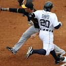Pittsburgh Pirates first baseman Andrew Lambo takes the throw from shortstop Jordy Mercer to get Detroit Tigers' Rajai Davis (20) out at first on a ground ball in the first inning of an exhibition spring training baseball game between the Detroit Tigers a