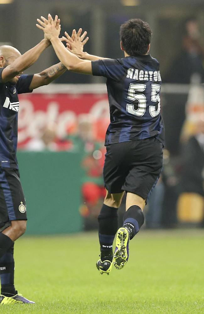 Inter Milan defender Yuto Nagatomo, right, of Japan, celebrates with his teammate Brazilian defender Cicero Jonathan after scoring during the Serie A soccer match between Inter Milan and Livorno at the San Siro stadium in Milan, Italy, Saturday, Nov. 9, 2013