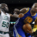 Golden State Warriors power forward Marreese Speights (5) controls the ball against Boston Celtics center Joel Anthony (50) in the second half of an NBA basketball game in Boston, Wednesday, March 5, 2014. The Warriors won 108-88 The Associated Press