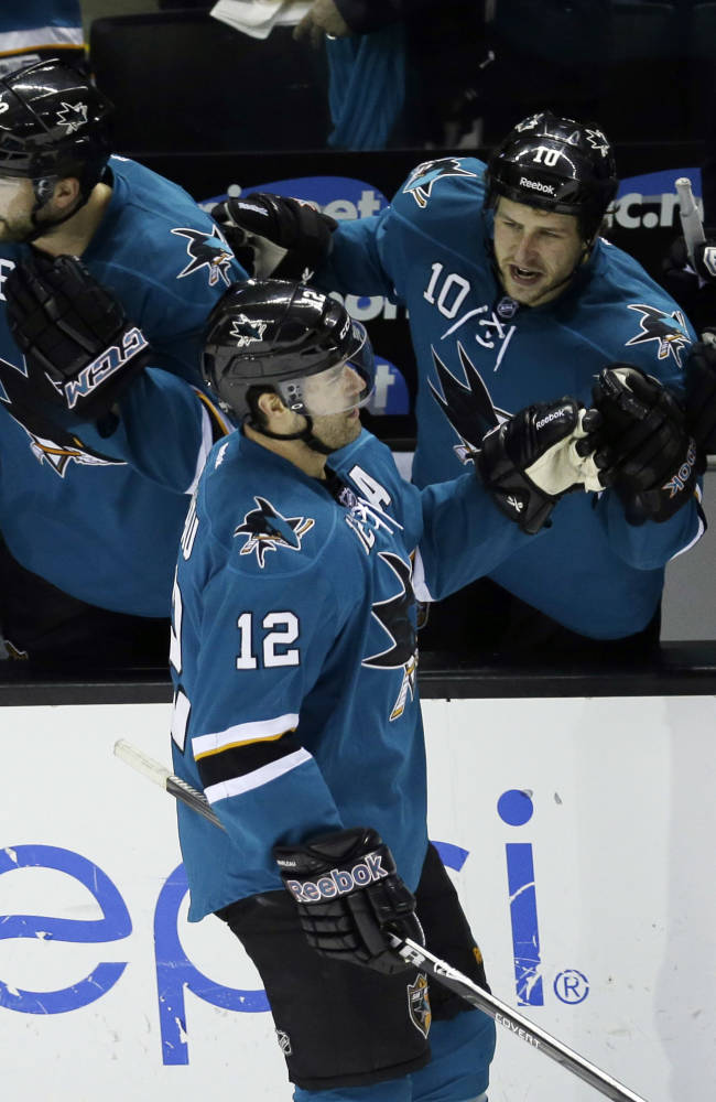 San Jose Sharks' Patrick Marleau (12) celebrates his goal with teammates during the second period of an NHL hockey game against the New York Islanders on Tuesday, Dec. 10, 2013, in San Jose, Calif