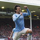 Manchester City's David Silva celebrates after scoring his second goal against Liverpool during their English Premier League soccer match at Anfield Stadium, Liverpool, England, Sunday, April 13, 2014