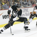 Pittsburgh Penguins' Evgeni Malkin (71), of Russia. tries to get the puck around Anaheim Ducks' Cam Fowler (4) in the second period of an NHL hockey game on Thursday, Oct. 9, 2014 in Pittsburgh The Associated Press