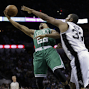 Boston Celtics' Phil Pressey (26) tries to shoot over San Antonio Spurs' Boris Diaw (33), of France, during the second half of an NBA basketball game, Wednesday, Nov. 20, 2013, in San Antonio The Associated Press