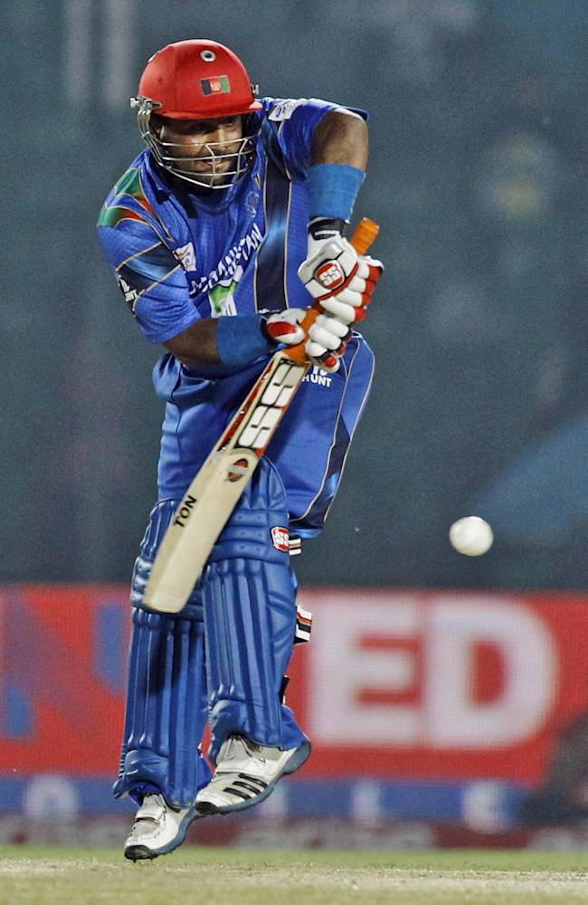 Afghanistan's Mohammad Shahzad plays a shot during the Asia Cup one-day international cricket tournament against Pakistan in Fatullah, near Dhaka, Bangladesh, Thursday, Feb. 27, 2014