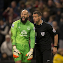 Everton goalkeeper Tim Howard, left, remonstrates with referee Andre Marriner after the latter's award of a penalty to Manchester City during the English Premier League soccer match between Manchester City and Everton at the Etihad Stadium, Manchester, En