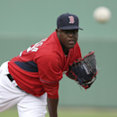 Boston Red Sox pitcher Rubby De La Rosa follows through on a warm-up pitch before an exhibition baseball game against Boston College, Thursday, Feb. 27, 2014, in Fort Myers, Fla The Associated Press