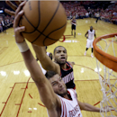 Houston Rockets' Chandler Parsons (25) goes up for a shot as Portland Trail Blazers' Nicolas Batum defends during the first half in Game 1 of an opening-round NBA basketball playoff series, Sunday, April 20, 2014, in Houston The Associated Press