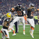 Denver Broncos' Emmanuel Sanders, left, celebrates with Detroit Lions' Golden Tate after scoring a touchdown during the first half of the NFL Football Pro Bowl Sunday, Jan. 25, 2015, in Glendale, Ariz The Associated Press