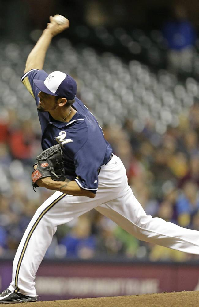 Milwaukee Brewers starting pitcher Matt Garza throws to the Kansas City Royals in the first inning of an exhibition baseball game Friday, March 28, 2014, in Milwaukee